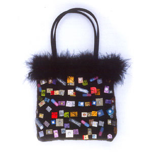 A black handbag, decorated with pills.