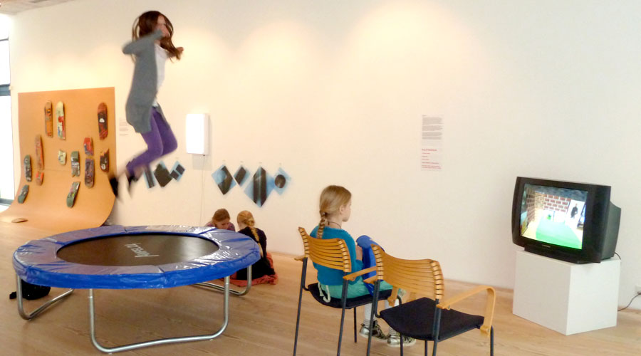 Children in art gallery, playing on trampoline, watching television
