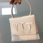 A handbag decorated with Long Acting Reversible Contraceptives
