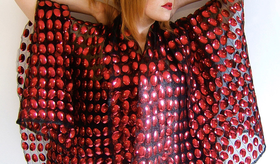 A woman in a coat of red-blood-cell sequins
